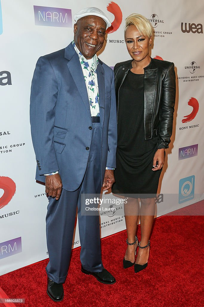 Musician Buddy Guy (L) and singer Emeli Sande arrive at the NARM Music Biz Awards dinner party at the Hyatt Regency Century Plaza on May 9, 2013 in Century City, California.