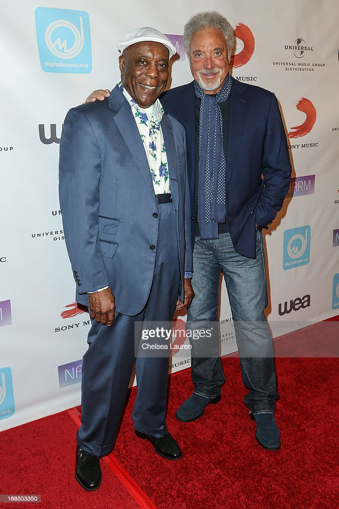 Musician Buddy Guy (L) and singer Tom Jones arrive at the NARM Music Biz Awards dinner party at the Hyatt Regency Century Plaza on May 9, 2013 in Century City, California.