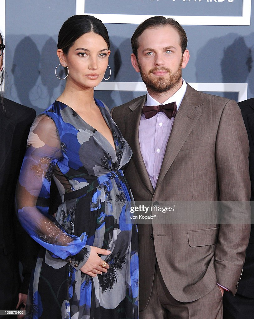 Musician <a gi-track='captionPersonalityLinkClicked' href=/galleries/search?phrase=Caleb+Followill&family=editorial&specificpeople=210594 ng-click='$event.stopPropagation()'>Caleb Followill</a> (R) of Kings of Leon and wife <a gi-track='captionPersonalityLinkClicked' href=/galleries/search?phrase=Lily+Aldridge&family=editorial&specificpeople=2110490 ng-click='$event.stopPropagation()'>Lily Aldridge</a> arrive at 54th Annual GRAMMY Awards held the at Staples Center on February 12, 2012 in Los Angeles, California.