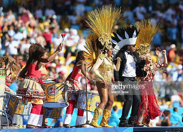 Musician Carlinhos Brown and singer Shakira perform during the closing ceremony prior to the 2014 FIFA World Cup Brazil Final match between Germany...