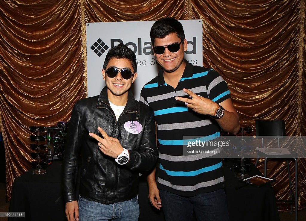 Musician Carlos Cruz (L) and Rafael Becerra with Polaroid Polarized Sunglasses at a gift lounge during the 14th annual Latin GRAMMY Awards at the Mandalay Bay Events Center on November 18, 2013 in Las Vegas, Nevada.
