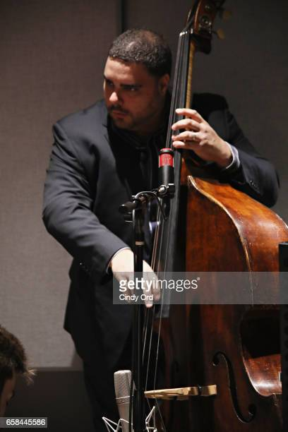 Musician Carlos Henriquez plays bass as Wynton Marsalis and Jon Batiste perform the music of John Lewis at Spotify Studio for Jazz at Lincoln...