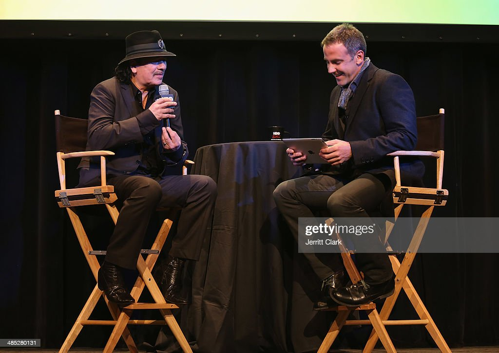 Musician Carlos Santana and Actor Carlos Ponce speak during a Q & A at the HBO Latino NYC Premiere of 'Santana: De Corazon' at Hudson Theatre on April 16, 2014 in New York City.