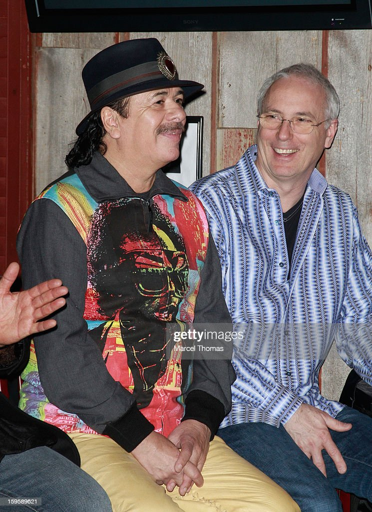 Musician Carlos Santana joins Peter Reed Smith [R] of PRS Guitars to unveil a commemorative guitar sculpture at House of Blues Las Vegas on January 16, 2013 in Las Vegas, Nevada.