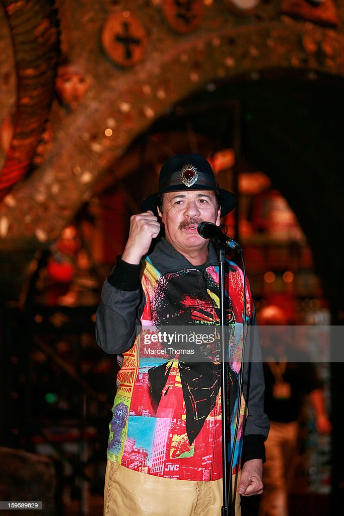 Musician Carlos Santana joins sculptor Dale Evers to unveil a commemorative guitar sculpture at House of Blues Las Vegas on January 16, 2013 in Las Vegas, Nevada.