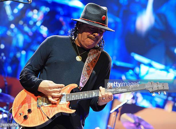 Musician Carlos Santana performs at Sprint Center on August 14 2014 in Kansas City Missouri