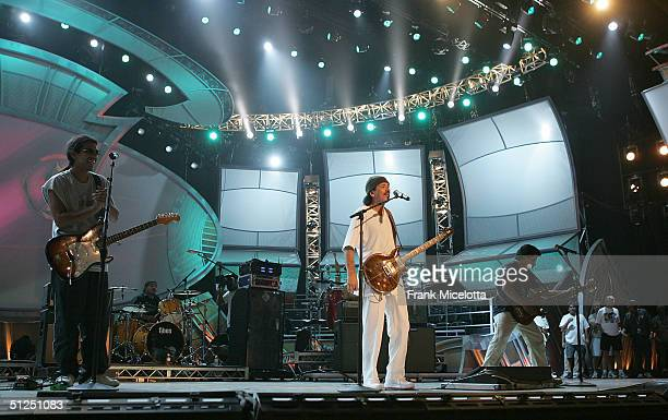 Musician Carlos Santana rehearses his performance with Los Lonely Boys for the '5th Annual Latin Grammy Awards' August 31 2004 at the Shrine...
