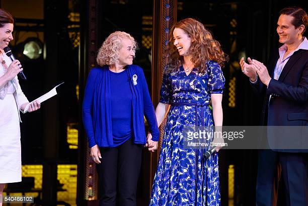 Musician Carole King and Chilina Kennedy receive a mayoral proclamation during the curtain call of the 1000th performance of 'Beautiful The Carole...