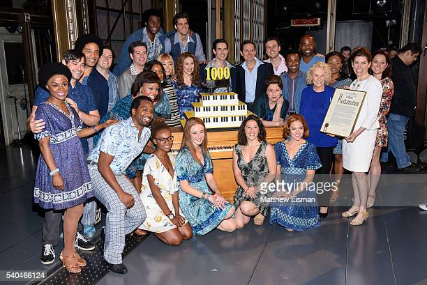 Musician Carole King and NYC Comissioner of Media and Entertainment Julie Menin pose together with cast and crew members after the curtain call of...