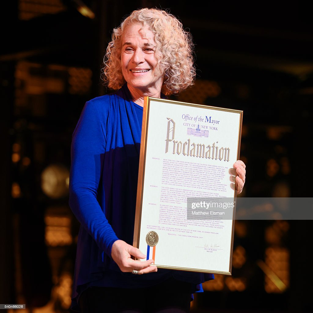 Musician <a gi-track='captionPersonalityLinkClicked' href=/galleries/search?phrase=Carole+King+-+Musician&family=editorial&specificpeople=211440 ng-click='$event.stopPropagation()'>Carole King</a> receives a mayoral proclamation during the curtain call of the 1000th performance of 'Beautiful - The <a gi-track='captionPersonalityLinkClicked' href=/galleries/search?phrase=Carole+King+-+Musician&family=editorial&specificpeople=211440 ng-click='$event.stopPropagation()'>Carole King</a> Musical' at Stephen Sondheim Theatre on June 15, 2016 in New York City.