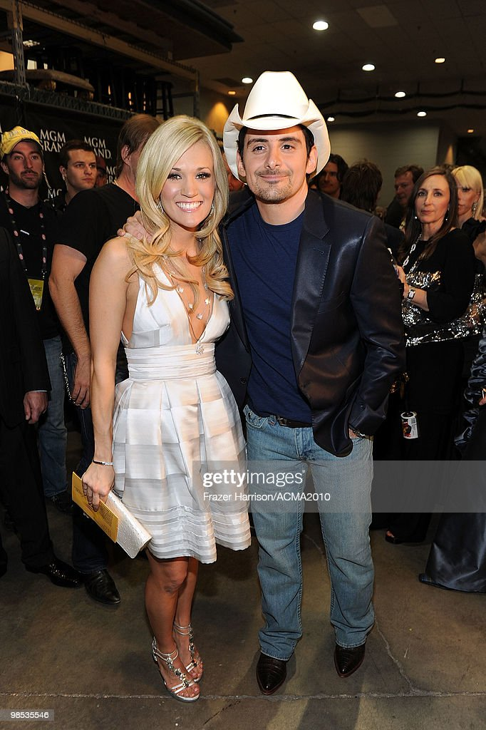 Musician <a gi-track='captionPersonalityLinkClicked' href=/galleries/search?phrase=Carrie+Underwood&family=editorial&specificpeople=204483 ng-click='$event.stopPropagation()'>Carrie Underwood</a> and <a gi-track='captionPersonalityLinkClicked' href=/galleries/search?phrase=Brad+Paisley&family=editorial&specificpeople=206616 ng-click='$event.stopPropagation()'>Brad Paisley</a> pose backstage at the 45th Annual Academy of Country Music Awards at the MGM Grand Garden Arena on April 18, 2010 in Las Vegas, Nevada.