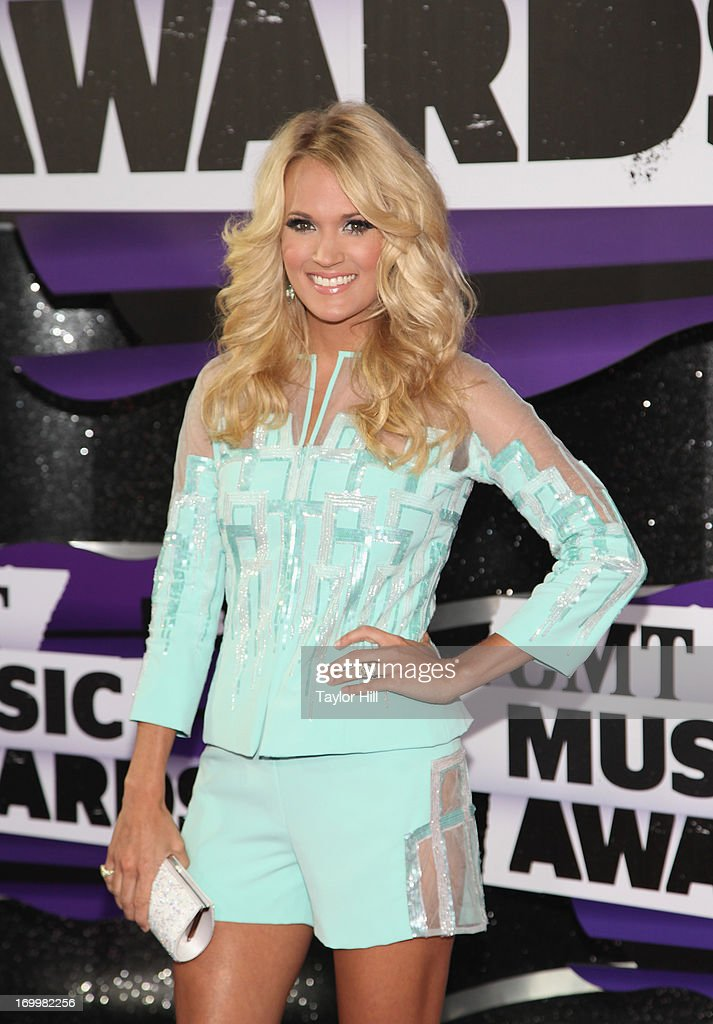 Musician <a gi-track='captionPersonalityLinkClicked' href=/galleries/search?phrase=Carrie+Underwood&family=editorial&specificpeople=204483 ng-click='$event.stopPropagation()'>Carrie Underwood</a> attends the 2013 CMT Music awards at the Bridgestone Arena on June 5, 2013 in Nashville, Tennessee.