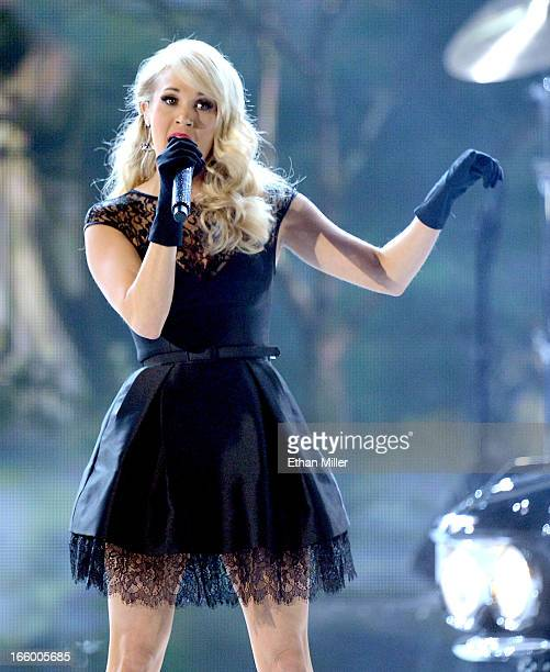 Musician Carrie Underwood performs onstage during the 48th Annual Academy of Country Music Awards at the MGM Grand Garden Arena on April 7 2013 in...