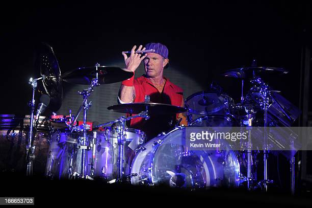 Musician Chad Smith of the band Red Hot Chili Peppers performs onstage during day 3 of the 2013 Coachella Valley Music Arts Festival at the Empire...