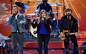 Musician Charles Kelley Hilary Scott and Dave Haywood of Lady Antebellum perform onstage at The 41st Annual People's Choice Awards at Nokia Theatre...