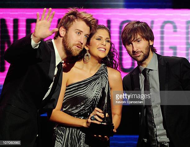 Musician Charles Kelley singer Hillary Scott and Dave Haywood of the band Lady Antebellum the Country Music Favorite Band Duo or Group award onstage...