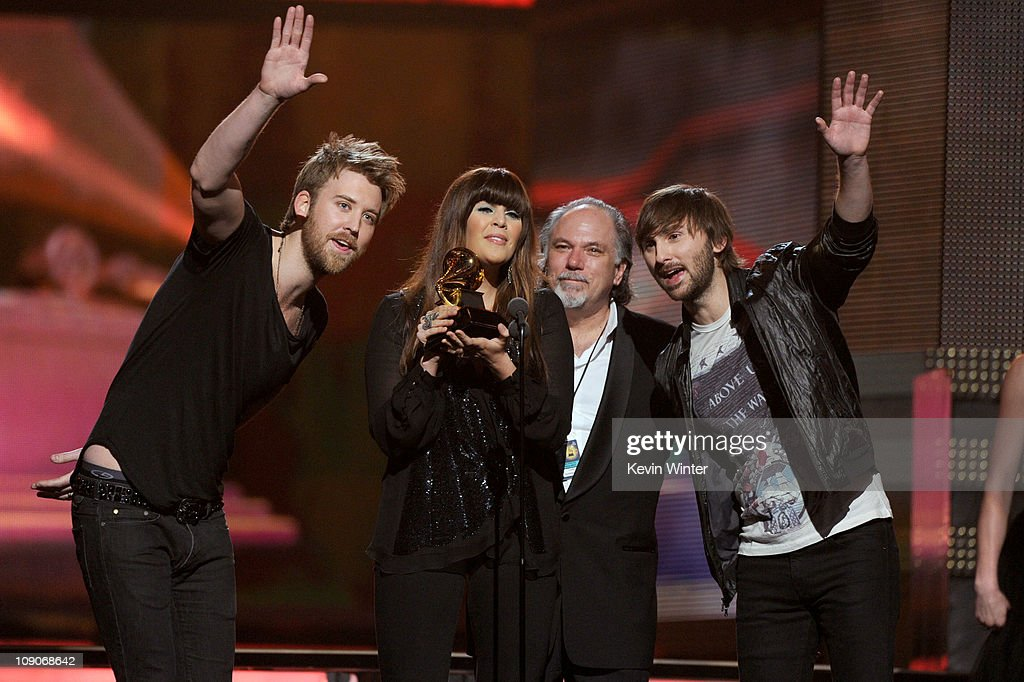Musician <a gi-track='captionPersonalityLinkClicked' href=/galleries/search?phrase=Charles+Kelley&family=editorial&specificpeople=3935435 ng-click='$event.stopPropagation()'>Charles Kelley</a>, singer Hillary Scott, guest and musician <a gi-track='captionPersonalityLinkClicked' href=/galleries/search?phrase=Dave+Haywood&family=editorial&specificpeople=4620526 ng-click='$event.stopPropagation()'>Dave Haywood</a> of Lady Antebellum accept the Country Album Award onstage during The 53rd Annual GRAMMY Awards held at Staples Center on February 13, 2011 in Los Angeles, California.