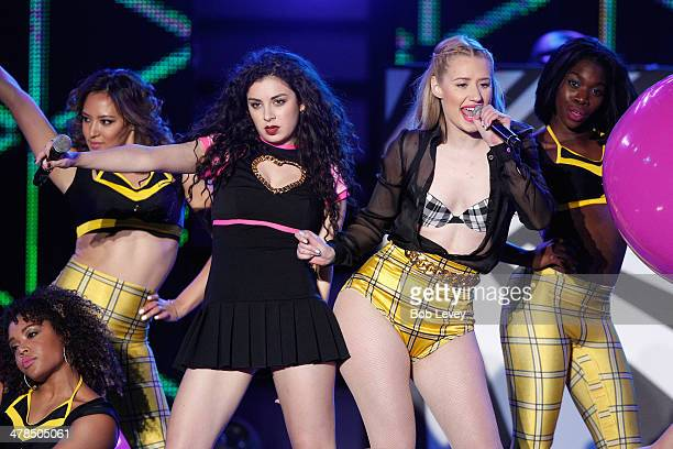 Musician Charli XCX and rapper Iggy Azalea perform onstage at the 2014 mtvU Woodie Awards and Festival on March 13 2014 in Austin Texas