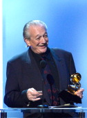 Musician Charlie Musselwhite accepts the Best Blues Album award for 'Get Up' onstage during the 56th GRAMMY Awards PreTelecast Show at Nokia Theatre...