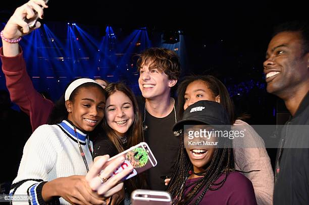 Musician Charlie Pluth poses with comedian Chris Rock and his daughter Zahra Savannah Rock at Z100's Jingle Ball 2016 at Madison Square Garden on...