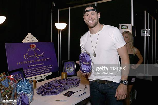 Musician Chase Rice stuffs a Crown Royal CAMO care package to be sent to troops overseas backstage at the 2015 CMT Awards at Bridgestone Arena on...