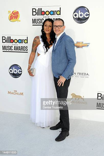 Musician Chester Bennington of Linkin Park and wife Talinda Ann Bentley arrive at the 2012 Billboard Music Awards at the MGM Grand Garden Arena on...