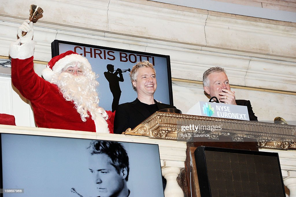 Musician <a gi-track='captionPersonalityLinkClicked' href=/galleries/search?phrase=Chris+Botti&family=editorial&specificpeople=223897 ng-click='$event.stopPropagation()'>Chris Botti</a> (C) and Chief Executive Officer of NYSE Euronext Duncan Niederauer (R) ring the closing bell at the New York Stock Exchange on December 24, 2012 in New York City.