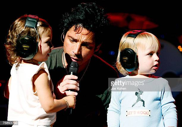 Musician Chris Cornell and his children Toni and Christopher on stage during a concert at the Beacon Theatre July 31 2007 in New York City