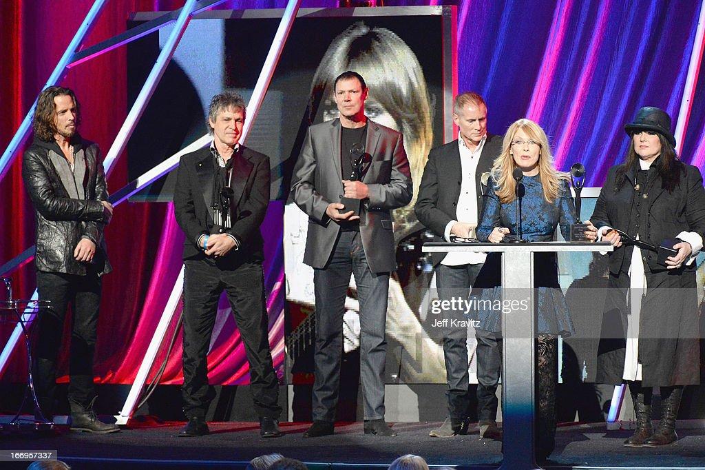 Musician Chris Cornell and inductees Roger Fisher Michael DeRosier Steve Fossen Nancy Wilson Ann Wilson and Howard Leese of Heart speak onstage at...