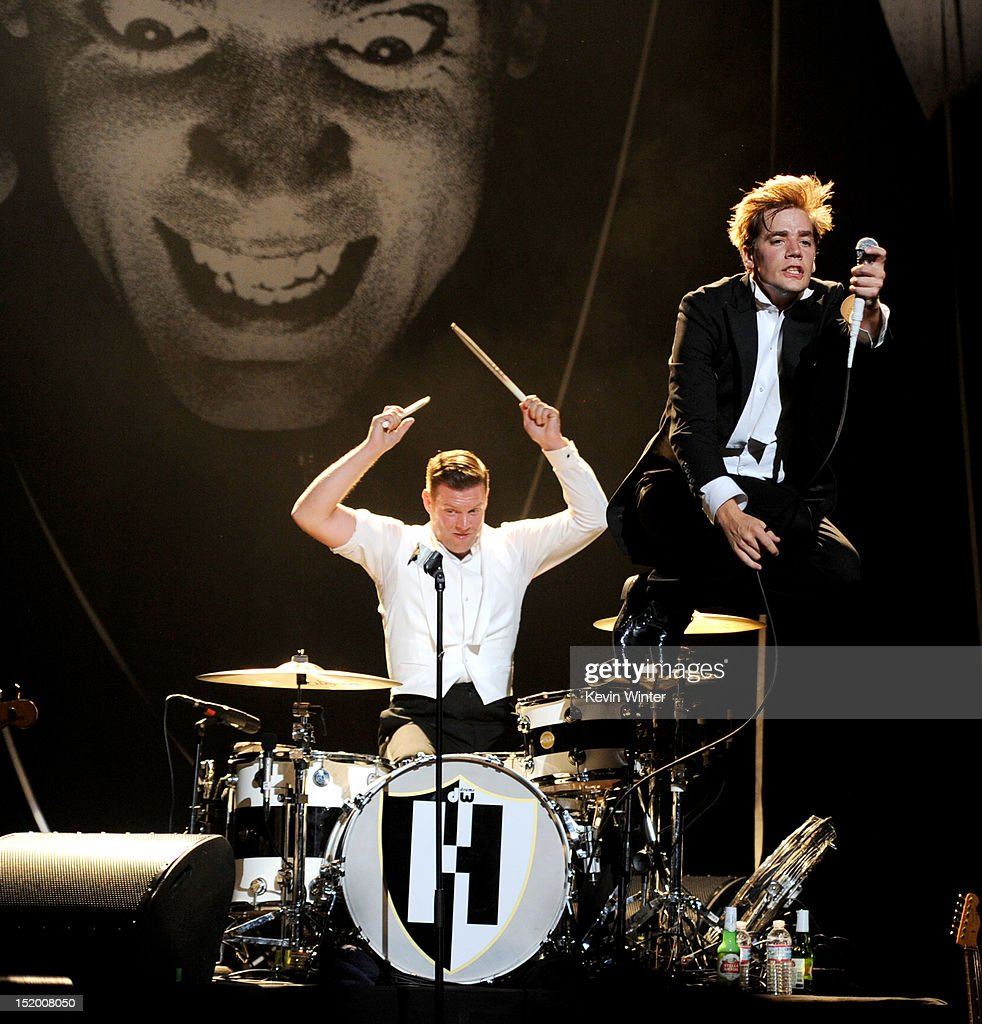 Musician Chris Dangerous (L) and singer Howlin' Pelle Almqvist of The Hives perform at the Wiltern Theater on September 14, 2012 in Los Angeles, California.