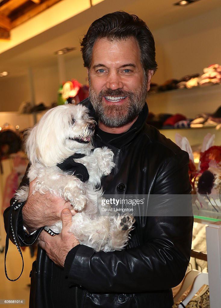 Musician Chris Isaak holding Rodney attends Artists with Animals at RonRobinson on November 29, 2016 in Santa Monica, California.