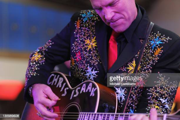 Musician Chris Isaak performs during JetBlue's Live from T5 Concert Series at JFK Airport on December 15 2011 in New York City