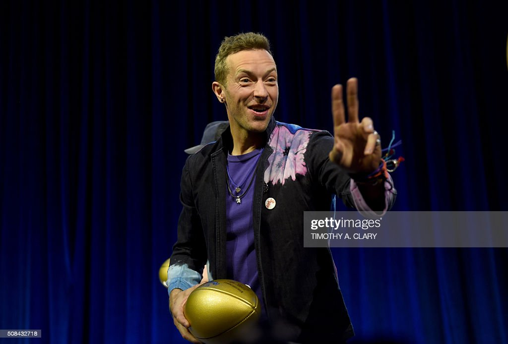 Musician Chris Martin of Coldplay poses with footballs at the Pepsi Super Bowl Halftime Press Conference on February 4 2016 at the Moscone Convention...