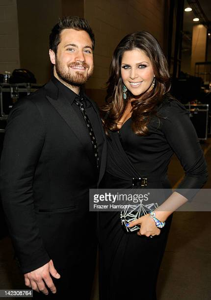 Musician Chris Tyrrell and singer Hillary Scott of the group Lady Antebellum pose backstage at the 47th Annual Academy Of Country Music Awards held...