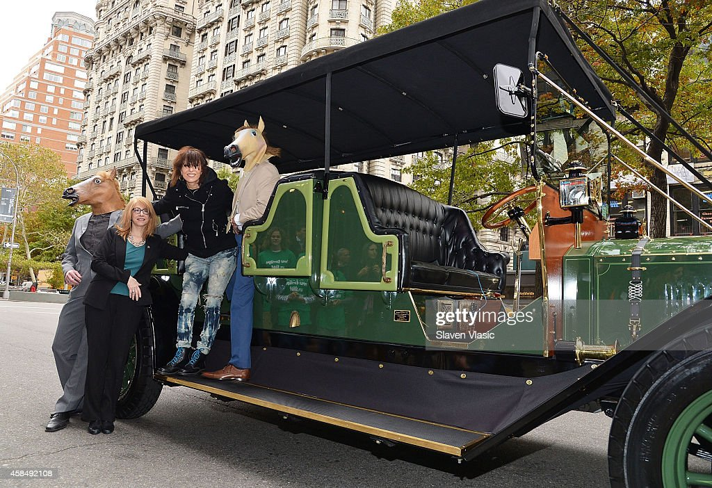 Musician Chrissie Hynde of The Pretenders (2nd R) and NYS Assembly member Linda B. Rosenthal (2nd L) of the 67th Assembly District unveil the eCarriage, the horseless vehicle meant to replace horse carriage industry in NYC, outside of Beacon Theatre on November 5, 2014 in New York City.