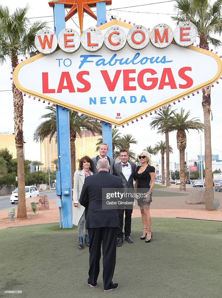 Musician Chrissie Hynde of The Pretenders, Senior Vice President of media campaigns for PETA Dan Mathews, production designer Jack Ryan and actress Pamela Anderson stand as Paul DeVido officates the wedding of Dan Mathews and Jack Ryan at the Welcome to Fabulous Las Vegas sign on November 27, 2014 in Las Vegas, Nevada.