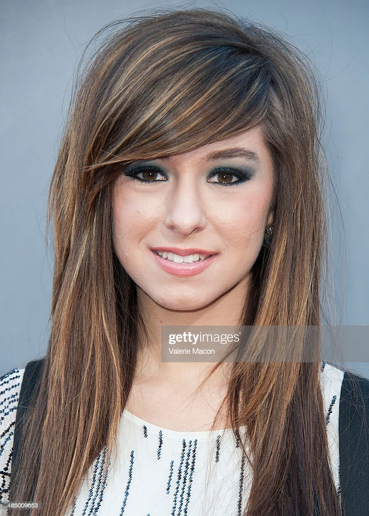 Musician <a gi-track='captionPersonalityLinkClicked' href=/galleries/search?phrase=Christina+Grimmie&family=editorial&specificpeople=7293581 ng-click='$event.stopPropagation()'>Christina Grimmie</a> arrives at NBC's 'The Voice' Season 6 Top 12 Red Carpet Event at Universal CityWalk on April 15, 2014 in Universal City, California.