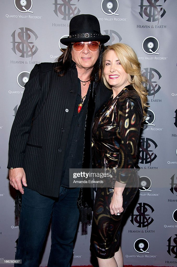 Musician Chuck Wright (L) and Dana Kennedy arrive at the Heaven And Earth 'Dig' world premiere album release party at The Fonda Theatre on April 10, 2013 in Los Angeles, California.