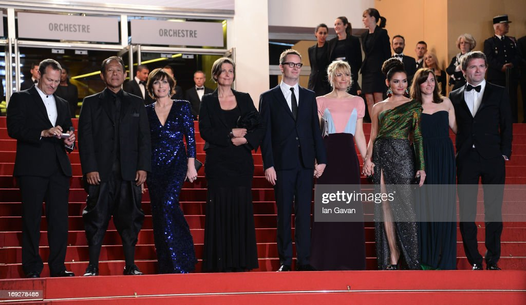 Musician Cliff Martinez, actors Vithaya Pansringarm, Kristin Scott Thomas, producer Lene Borglum, director Nicolas Winding Refn and is wife Liv Corfixen, actors Rhatha Phongam and Matthew Newman attend the 'Only God Forgives' Premiere during the 66th Annual Cannes Film Festival at Palais des Festivals on May 22, 2013 in Cannes, France.