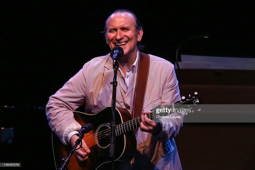 Musician <a gi-track='captionPersonalityLinkClicked' href=/galleries/search?phrase=Colin+Hay&family=editorial&specificpeople=1953993 ng-click='$event.stopPropagation()'>Colin Hay</a> performs during A Prairie Home Companion taping at The Greek Theatre on June 7, 2013 in Los Angeles, California.