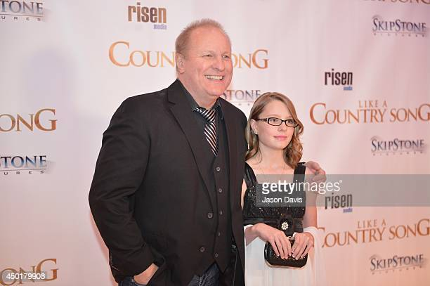 Musician Collin Raye and Actress Mattie Bell attend the 'Like A Country Song' premiere at Regal Cinemas on June 5 2014 in Nashville Tennessee