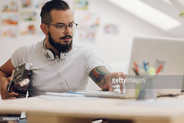 Musician Composing Music In His Recording Studio.