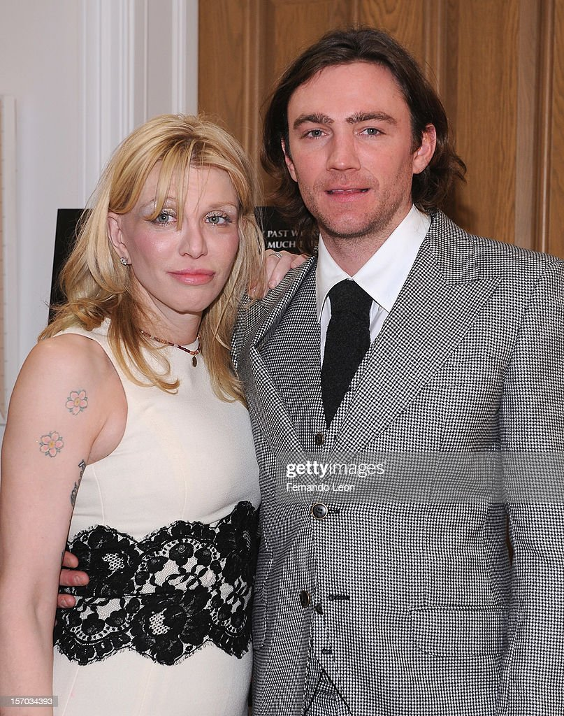 Musician Courtney Love and director/writer Jay Bulger (R) attend the 'Beware Of Mr. Baker' New York Screening at Crosby Street Hotel on November 27, 2012 in New York City.