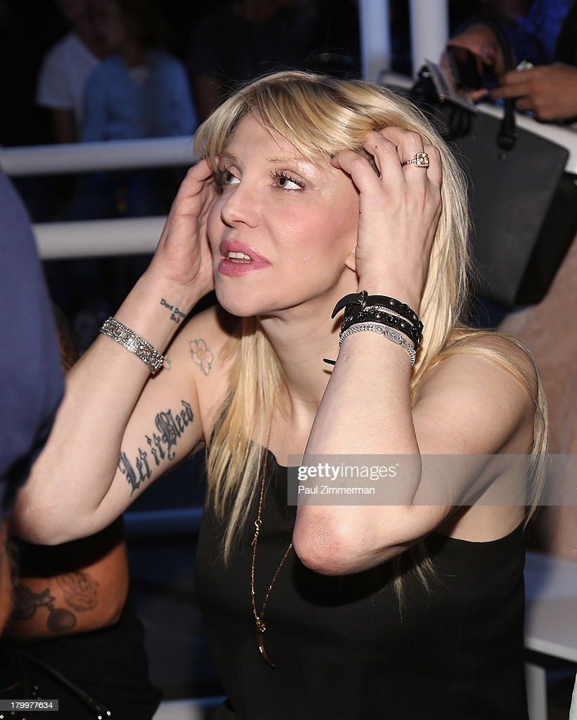 Musician <a gi-track='captionPersonalityLinkClicked' href=/galleries/search?phrase=Courtney+Love&family=editorial&specificpeople=156418 ng-click='$event.stopPropagation()'>Courtney Love</a> attends the Alexander Wang show during Spring 2014 Mercedes-Benz Fashion Week at Pier 94 on September 7, 2013 in New York City.