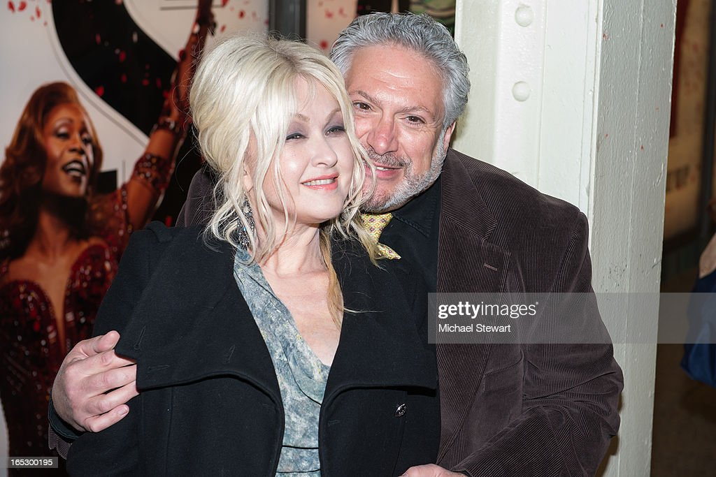 Musician <a gi-track='captionPersonalityLinkClicked' href=/galleries/search?phrase=Cyndi+Lauper&family=editorial&specificpeople=171290 ng-click='$event.stopPropagation()'>Cyndi Lauper</a> (L) and actor <a gi-track='captionPersonalityLinkClicked' href=/galleries/search?phrase=Harvey+Fierstein&family=editorial&specificpeople=206751 ng-click='$event.stopPropagation()'>Harvey Fierstein</a> attend Broadway's 'Kinky Boots' Everybody Say Yeah Ad Unveiling in Times Square on April 2, 2013 in New York City.