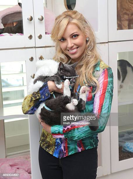 Musician Dalal Bruchmann and Bagel aka 'Sunglass Cat' attend CATFE's Cat Cafe Pop Up Celebration at NKLA Pet Adoption Center on April 10 2015 in Los...