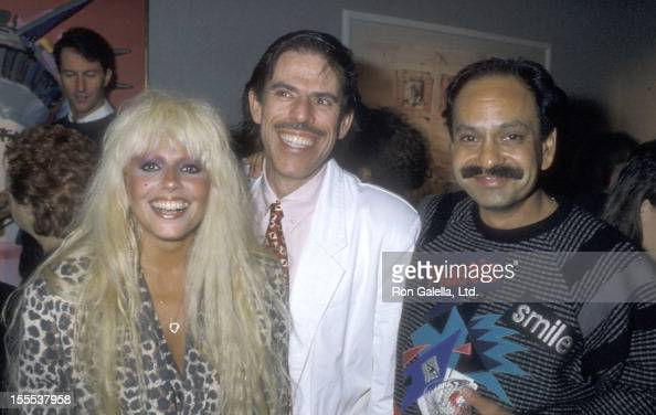 Musician Dale Bozzio artist Peter Max and actor Cheech Marin attend Peter Max's Artwork Exhibition on October 16 1986 at Circle Fine Arts Gallery in...