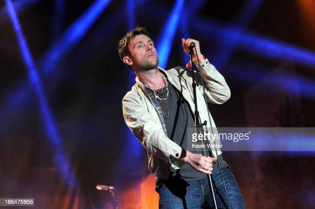 Musician Damon Albarn of the band Blur performs onstage during day 1 of the 2013 Coachella Valley Music Arts Festival at the Empire Polo Club on...