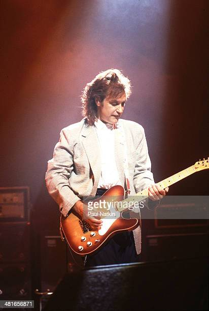 Musician Dave Davies of the group The Kinks performs onstage Chicago Illinois June 15 1987
