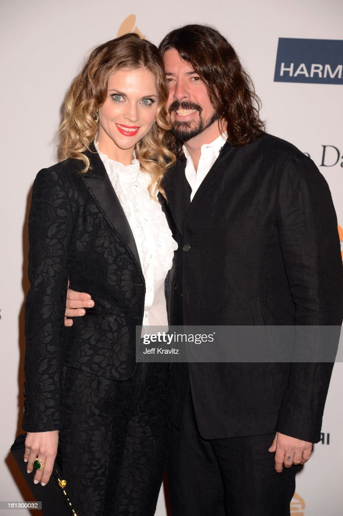 Musician <a gi-track='captionPersonalityLinkClicked' href=/galleries/search?phrase=Dave+Grohl&family=editorial&specificpeople=202539 ng-click='$event.stopPropagation()'>Dave Grohl</a> (R) and <a gi-track='captionPersonalityLinkClicked' href=/galleries/search?phrase=Jordyn+Blum&family=editorial&specificpeople=828157 ng-click='$event.stopPropagation()'>Jordyn Blum</a> arrives at Clive Davis and The Recording Academy's 2013 GRAMMY Salute to Industry Icons Gala held at The Beverly Hilton Hotel on February 9, 2013 in Beverly Hills, California.